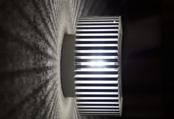 A light creating a theatrical pattern on the wall