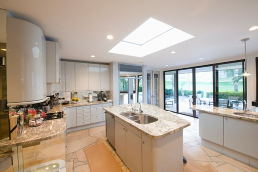 Skylight and light, reflective surfaces in a kitchen; good space planning