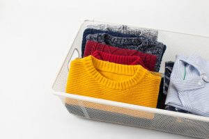 Clothes-neatly-folded-and-stored-in-container