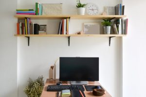 Home office working space with wooden bookshelves
