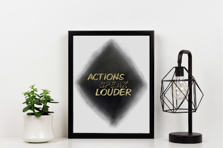 Black, white and a touch of gold interior decorating including motivational art print.