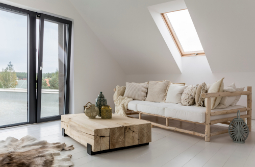 Small room with little furniture and sloped roof