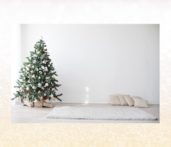 A minimalist room with a white, gold and silver Christmas tree.