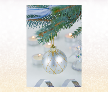 Silver and gold Christmas ball ornament on a tree