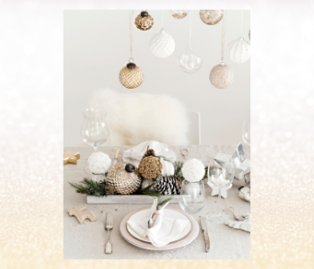 A festive table setting with white and natural pale bronze gold