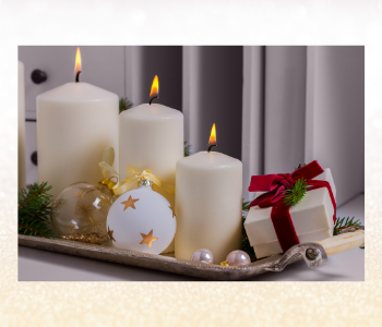 Burning white candles and Christmas decorations
