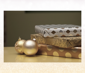 Gifts wrapped in white, silver and gold